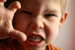 anger and attack as boy approaches camera
